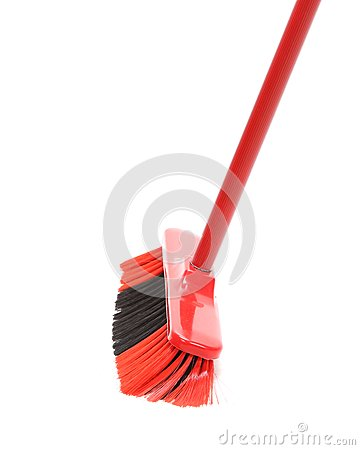 Close up of red black broom.