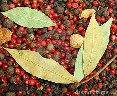 Close-up red and black pepper with bay leafs
