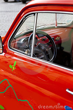 Close-up on a red mini vintage car s wheel
