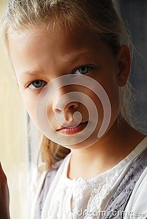 Close-up of sad pre-teen girl.