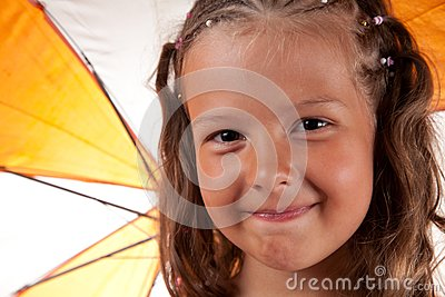 Close-up shot of cute little girl with umbrella