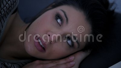 Close up face shot of young attractive hispanic woman upset in stress and insomnia lying anxious on bed and trying to sleep. Close up shot face of young stock video