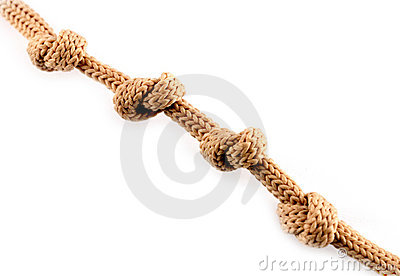 Close up shot of a rope with a four knots isolated