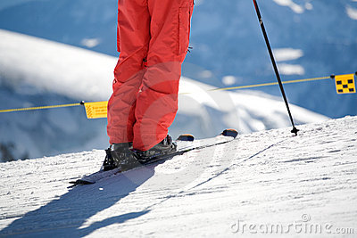 Close up of ski and trousers and ski pole