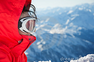 Close-up of skiing girl with goggles on slope