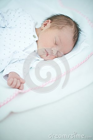 Close up of Sleeping Baby on White Bed