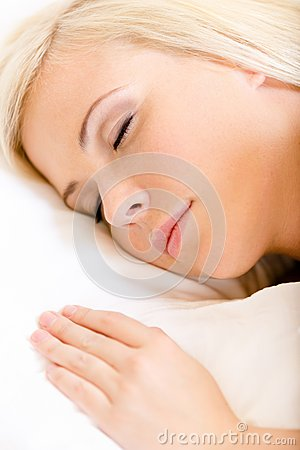 Close up of sleepy woman in bed