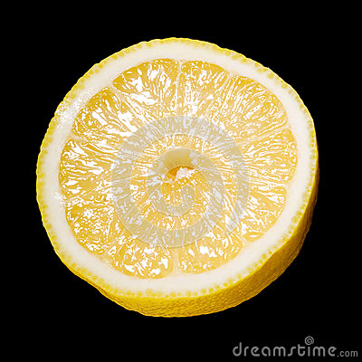 Close up of a sliced lemon over black