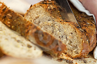 Close up of Slicing Wholemeal Seeded Bread Loaf