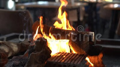 Wood burning for grilling sausages and steak stock video