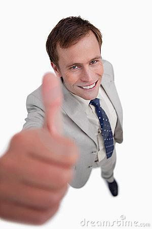 Close up of smiling businessman giving thumb up
