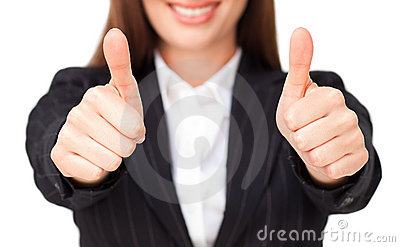 Close-up of smiling businesswoman doing thumbs up