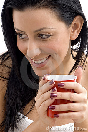Close up of smiling female holding coffee mug