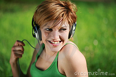 Close-up of smiling pretty girl listening to music