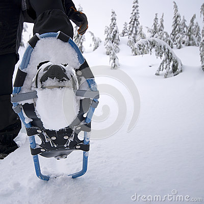 Close up of snowshoe on person
