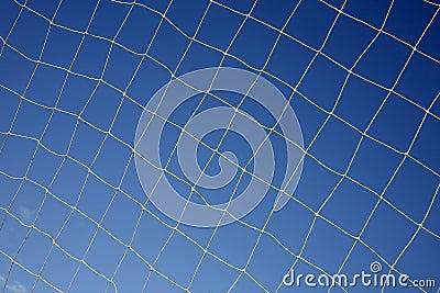 Close up of a soccer net.