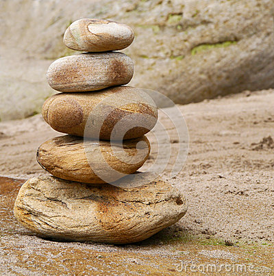 Close-up of stone stack on sandy beach