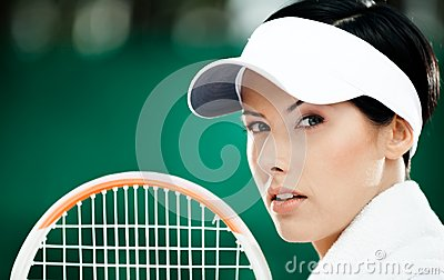 Close up of successful female tennis player