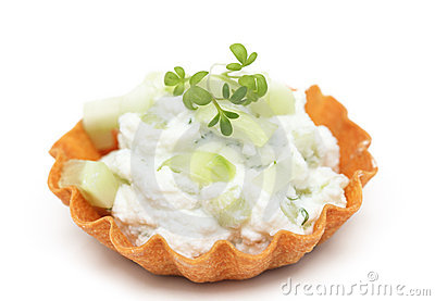 Close up tartlet filled with cream cheese