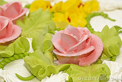 Close-up of tasty cake with cream, pink roses
