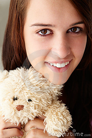 Close up teenage girl with cuddly toy