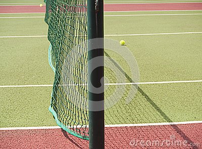 Close-up of tennis net and court