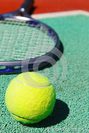 Close up of tennis racquet and ball