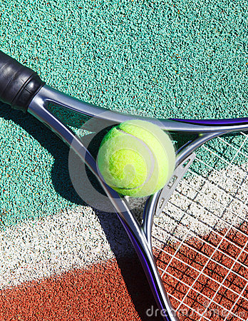 Close up of tennis racquet and ball on the tennis court