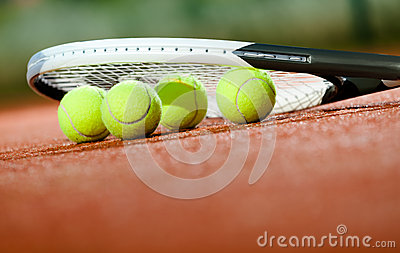 Close up of tennis racquet and balls