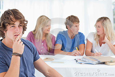 Close up of a thinking man sitting in front of his friends