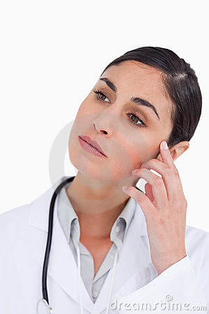 Close up of thoughtful female doctor