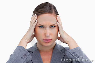 Close up of tradeswoman with headache