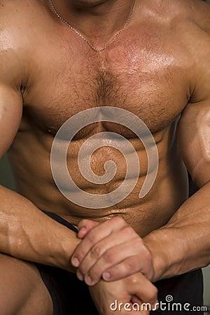 Close-up van een atletisch torso