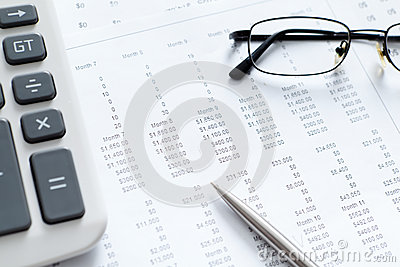 Close up view of business documents and spectacles