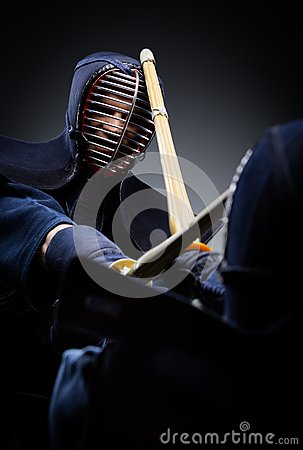 Close up view of competition of two kendo fighters
