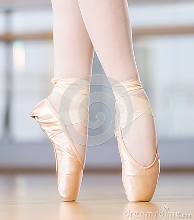 Close-up view of dancing legs of ballerina in pointes