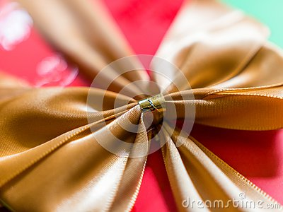 Close-up view of gold ribbon or bow on red gift box Stock Photo