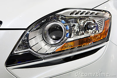 Close up view of headlight white car
