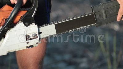 Close up view of man holding chainsaw stock footage