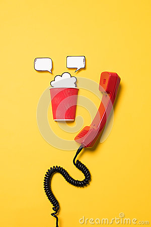 Free Close-up View Of Red Telephone Handset And Paper Cup With Speech Bubbles Royalty Free Stock Images - 97950759