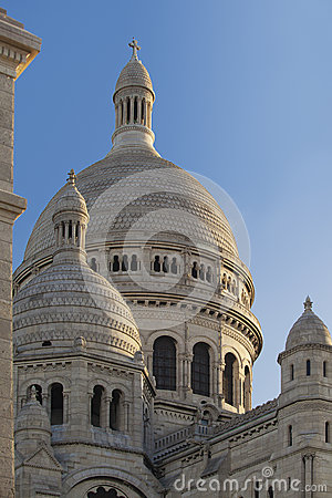 Close-up view of the towers Sacre Coeur Basilica at sunrise, Montmartre, Paris, Fr