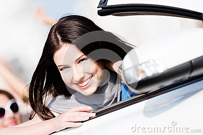 Close up view of woman in the white car