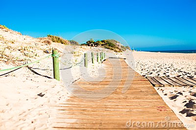 Close up view of a wood board walk in the beach