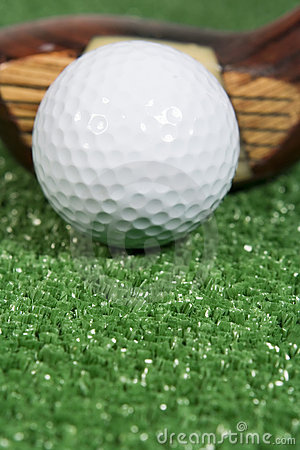 Close up of a vintage three wood golf club with ball