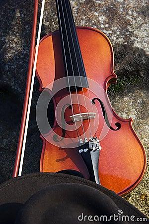 Close up of Violin and Cowboy Hat and Boulder.
