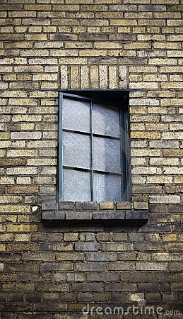 Close up of window on a weathered brick wall