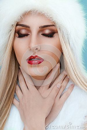 Close up of winter lady with strong red lipstick