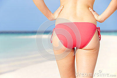 Close Up Of Woman In Bikini Walking On Tropical Beach