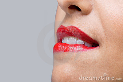 Close up woman biting her red lips
