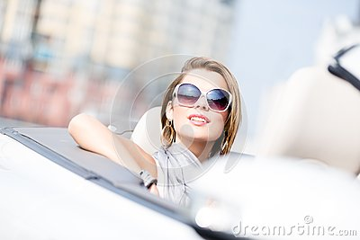 Close up of woman in the cabriolet